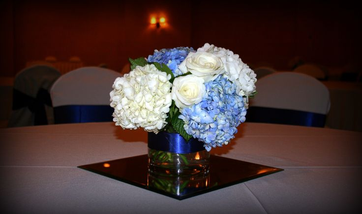 Simple elegant white and blue centerpieces with hydrangea