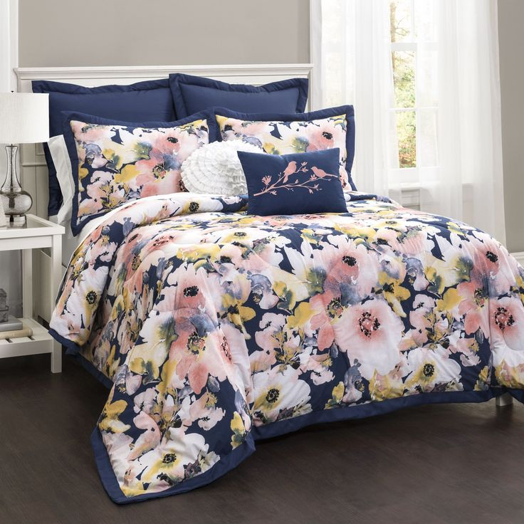 Features:  -Set includes 1 comforter, 2 shams, 2 euro shams and 2 decorative pillows.  -Face material: 100% Cotton.  -Back material: 100% Polyester.  Product Type: -Comforter/Comforter set.  Color: -B
