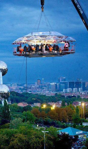 Hanging Restaurant, Belgium A 50-meters-above-ground dining event arranged by a professional event arranger of Benji Fun company. It provides seating for 22 complete with Chef, server, musician and you can select your own location without limitation. Guaranteed safety with the hoisting crane which can accommodate a whole band of musicians.