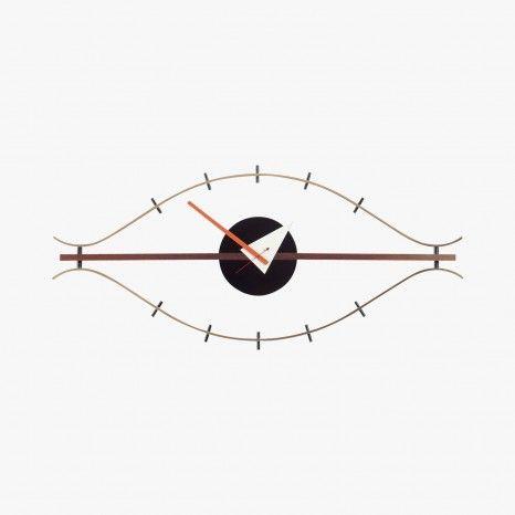 Horloge bois et laiton forme œil