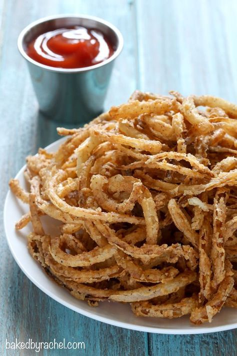Easy homemade crispy fried seasoned onion strings recipe from /bakedbyrachel/. A perfect topping for salads, burgers and more!