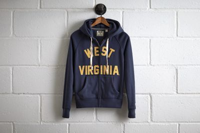 Tailgate West Virginia Zip Hoodie by  American Eagle Outfitters | The WVU Mountaineer, adorned in a custom-tailored buckskin costume and coonskin cap, fires his musket at the start of each game and with every score. Shop the Tailgate West Virginia Zip Hoodie and check out more at AE.com.