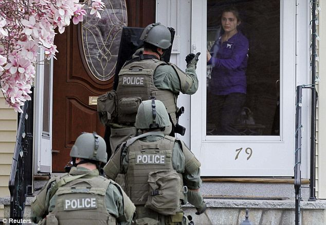 The controversial moment SWAT teams ordered innocent neighbors out of their houses at GUNPOINT during door-to-door searches for the Boston bomber