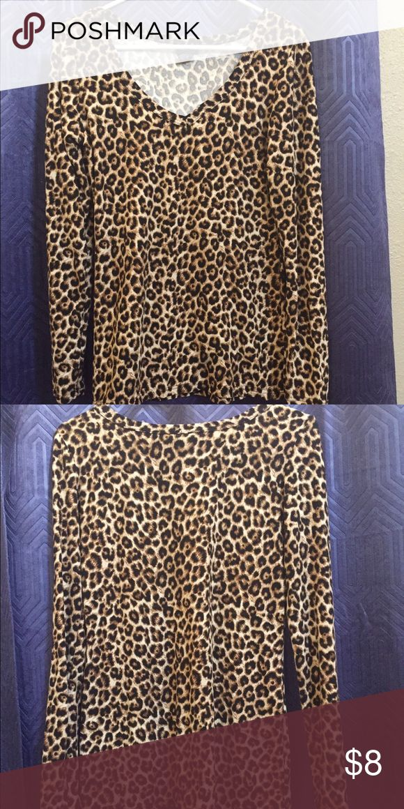 Leopard print shirt Leopard print shirt. Great for layering or wearing on its own. Material is rayon so stretchy and soft.  Brand new. Tops Tees - Long Sleeve