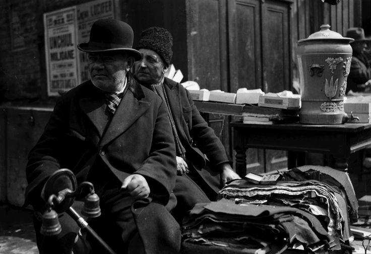 Man selling chime in Flea market, April 1932