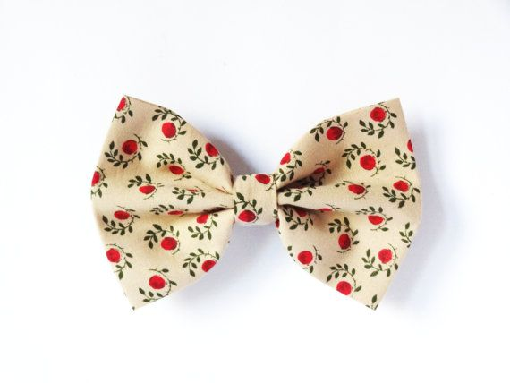 Cream hair bow with retro flower and berry print.  Wear it with a ponytail or accessorize your bun with one of these adorable bows. Or why not