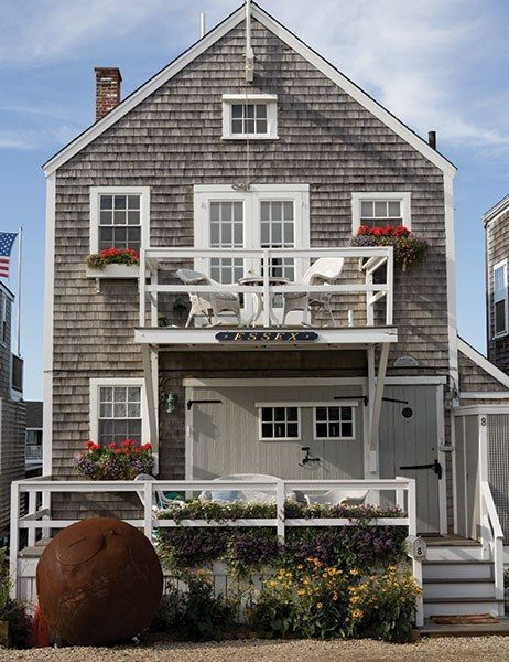 This two story cottage dubbed essex is surrounded by for Nantucket shingles