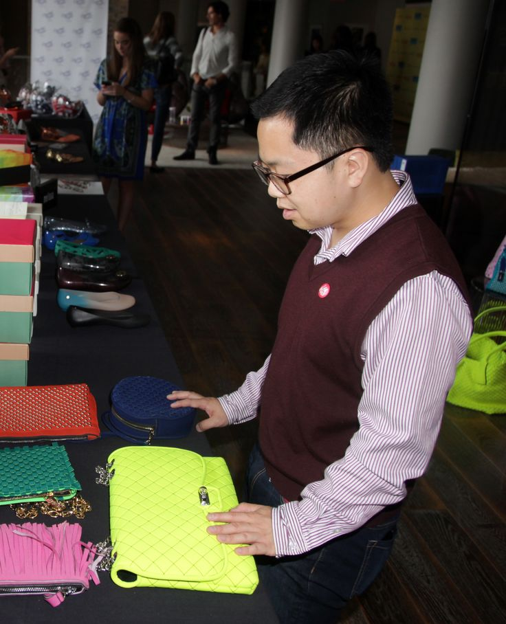 Matthew Moy learning about the new bags being offered at Melissa!