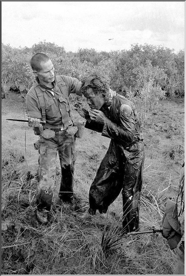 """January 9, 1964 a soldier of the Army of South Vietnam stabs a farmer, assuming that he was lying on the movements of the Viet Cong - North Vietnamese soldiers.""  Horst Faas."