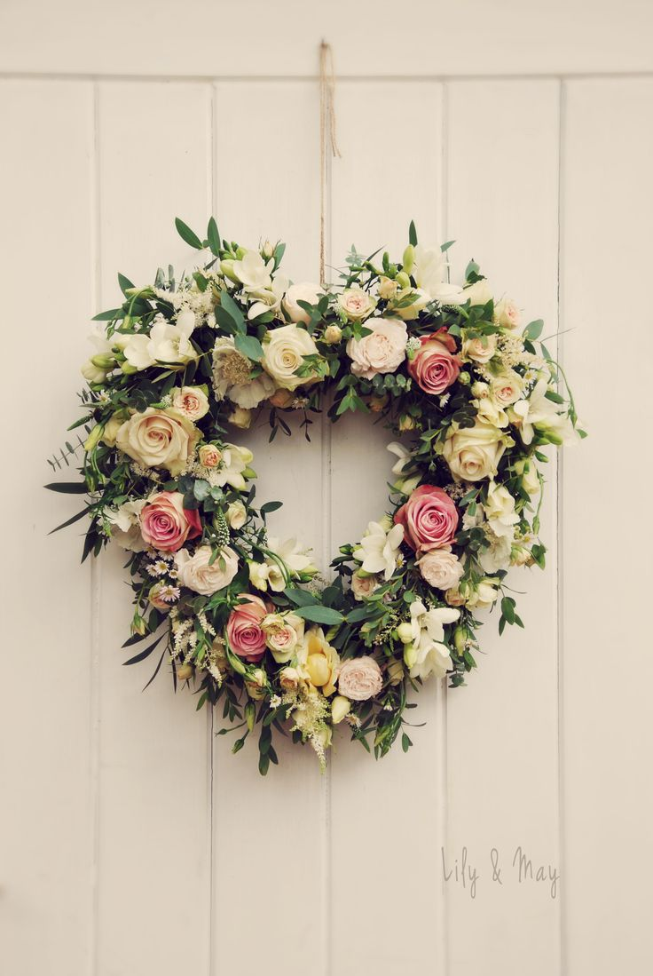 A rustic heart flower door decoration by Lily & May Floral Design