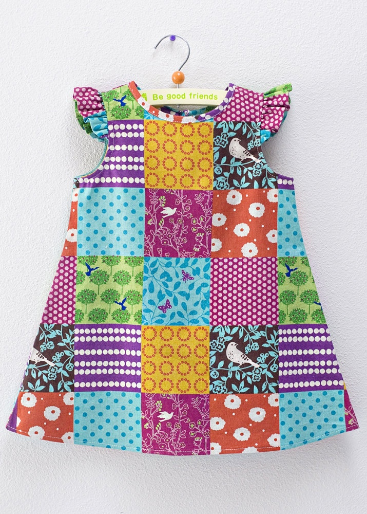 4T ruffled sleeve dress made with Echino patchwork fabric. $55.00, via Etsy.