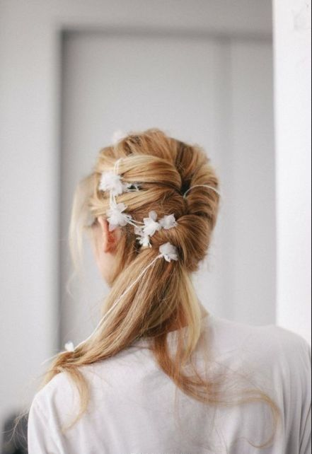 The handmade flowers are so amazing! This was growing in the hair!