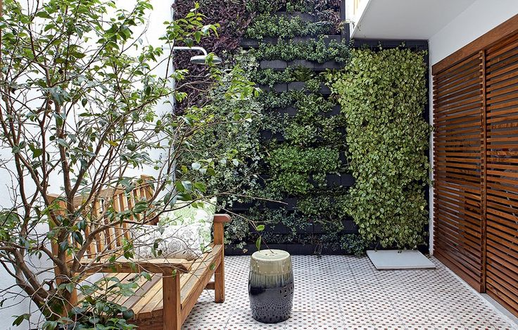 A tall, dense vertical garden like this almost makes this small space seem adjacent to the woods.