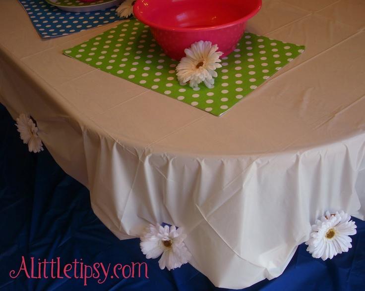 A cute idea....I would use cuter flowers or fabric rosettes though but I like this idea!