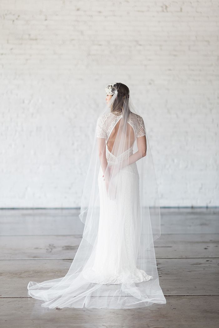 Open Back Bridal Gown with a Long Veil