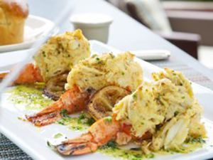 Stuffed Jumbo Shrimp - By filling the shrimp with a crabmeat stuffing, Smith & Wollensky can menu a signature item that contributes high-quality protein in a more price-conscious package.
