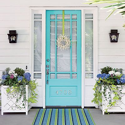 Make an entrance with bold colors and graphic door numbers.