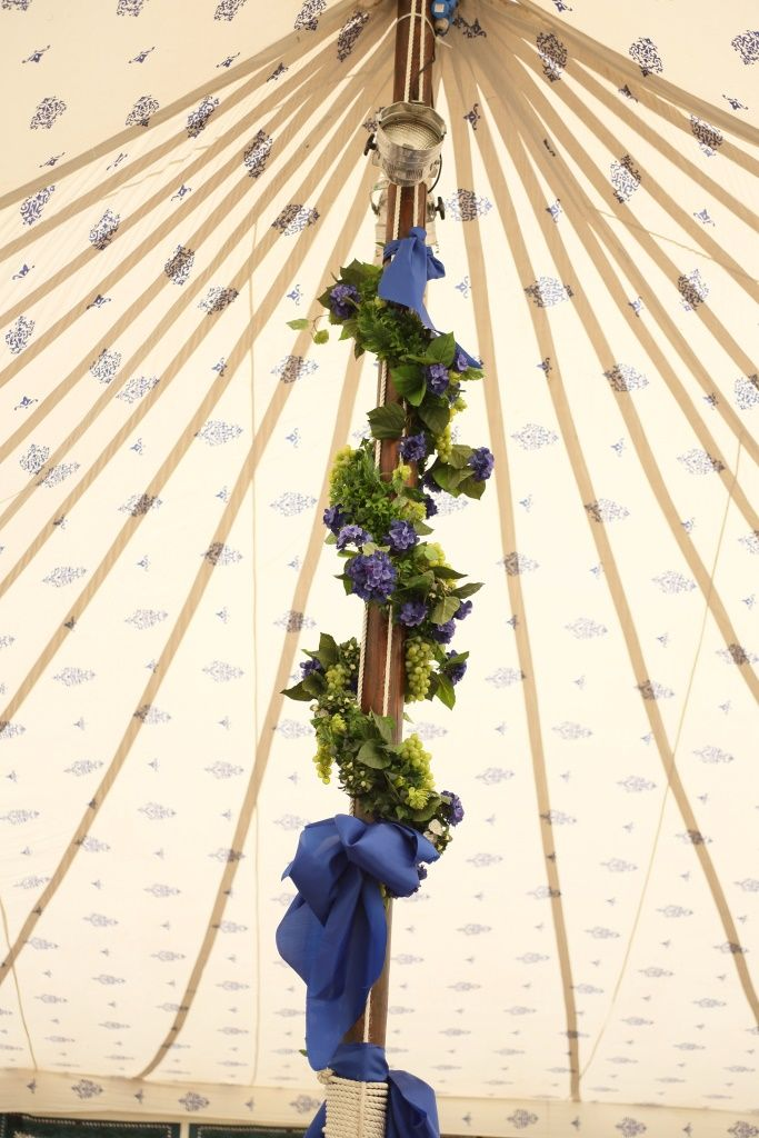 We love this image of the flowers around the pole within one of our Traditional Canvas Pole Tents.