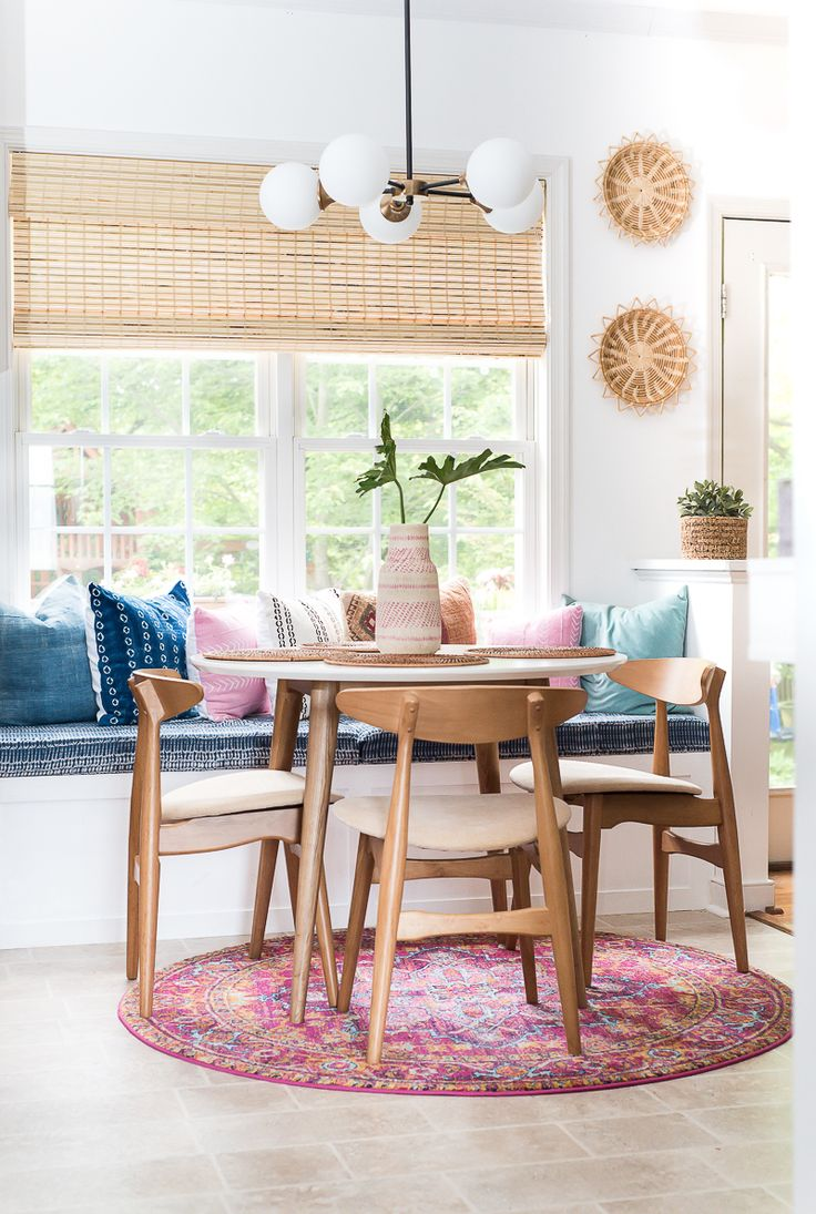 Don't you love a good room makeover? This amazing and cozy breakfast nook is super stylish and comfortable with the DIY built in bench! Check it out!