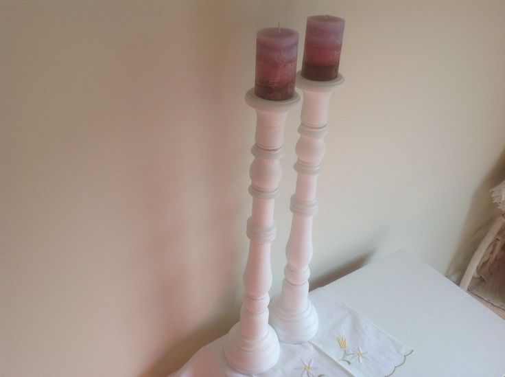 Pair of wooden candlesticks painted white with purple candles. $25 SOLD