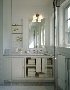 Light fixture, simple cabinet, marble counter, subway tile wall.  Interior Designers Bradley Thiergartner Berkshire Portfolio