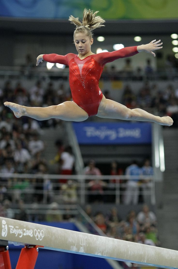 Shawn Johnson works the beam.