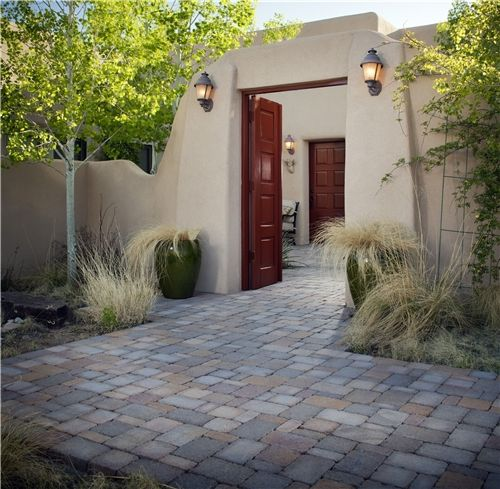 Love the red doors dividing this space, as well as the grasses softening the entry. Design by WaterQuest, Inc in Albuquerque, NM.