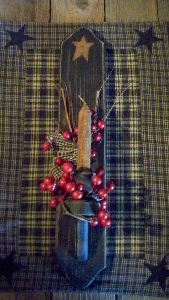 Primitive candle holder with berries and a cinnamon rolled candle I made.