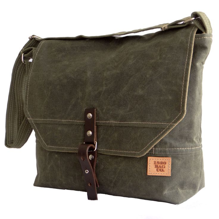 Men's Waxed Canvas Field Messenger Bag. Green Waxed Canvas, adjustable strap, canvas interior with Brown Leather closure. Waxed Canvas is water resistant. Great for school, day travel, or as an everyd