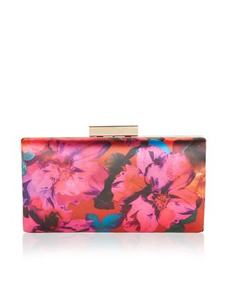 <p>Come into bloom at this season's parties and events with our Layla floral-print boxy clutch bag. This patterned piece has a sleek metal frame and cl...