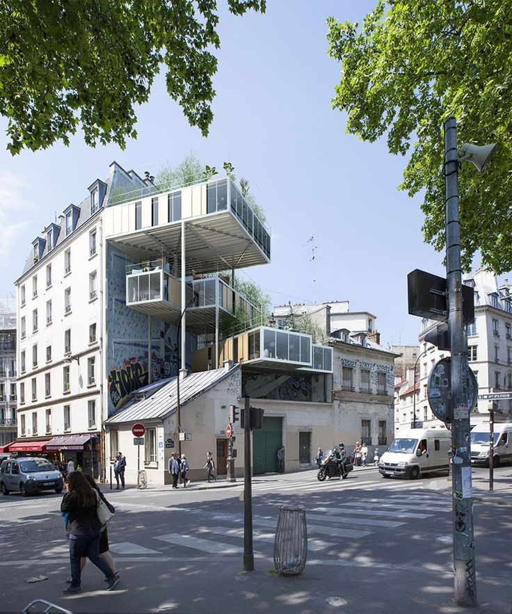 discovering ways of gaining new perspectives of the city, stéphane malka architecture have designed a housing intervention in paris which effectively works with existing buildings. named '3box', the units are suspended and raised in between two buildings on a corner plot.