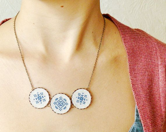 Cross stitch necklace with three navy blue ornament in bronze. $28.00, via Etsy.
