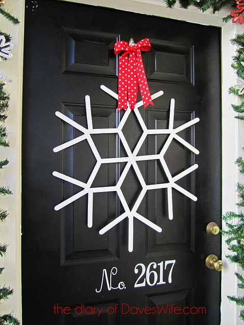 Popsicle stick snowflake wreath. Something this skinny would fit between the glass