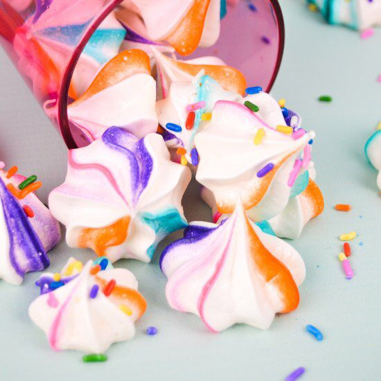 Make these sweet but simple rainbow meringues with a variety of colors!
