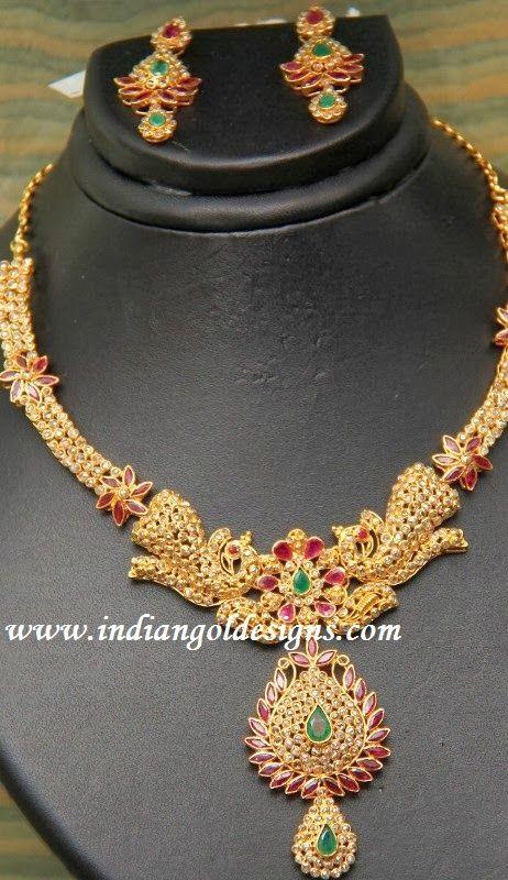 Gold and Diamond jewellery designs: uncut diamond necklace set