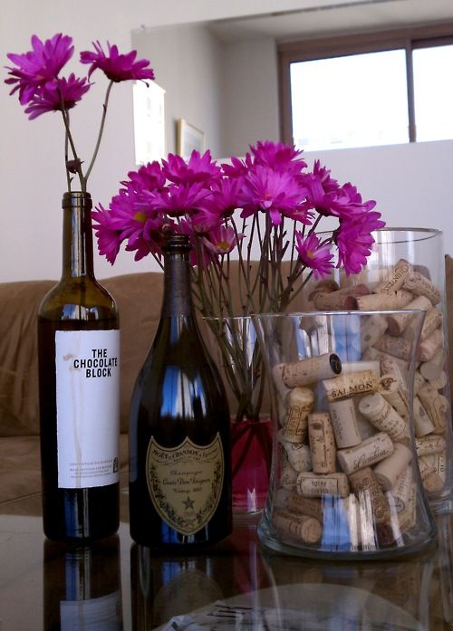 apartment decorations from wine bottles - I knew I was saving all those bottles and corks for something!
