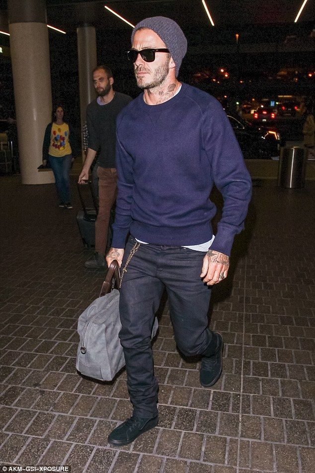 Hat trick: David Beckham went incognito in deep blue as he oozed cool in a jumper and jeans as he prepared to jet out of LAX on Sunday