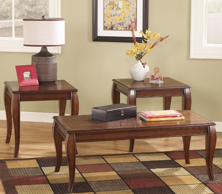 Striking traditional brown coffee table set transforms home decors. Inlay veneers and hardwood solids wood top stylish flared legs embellished in rich finish.