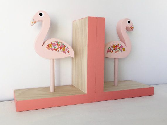 These playful Flamingo Bookends will add fun and function to a little girls room or a tropical touch to a home. DIMENSIONS: 12 x 7 x 3 1/2  WOOD: Sustainably harvested poplar wood is carefully selected, cut to shape and sanded smooth.  PAINT: Non-toxic paint.  PAPER: I delicately hand cut the Flamingos wings and eyes from paper. SEALER: The finished product is sealed with several coats of a non-toxic sealer for protection. No need to worry about your little one breathing in icky fumes.