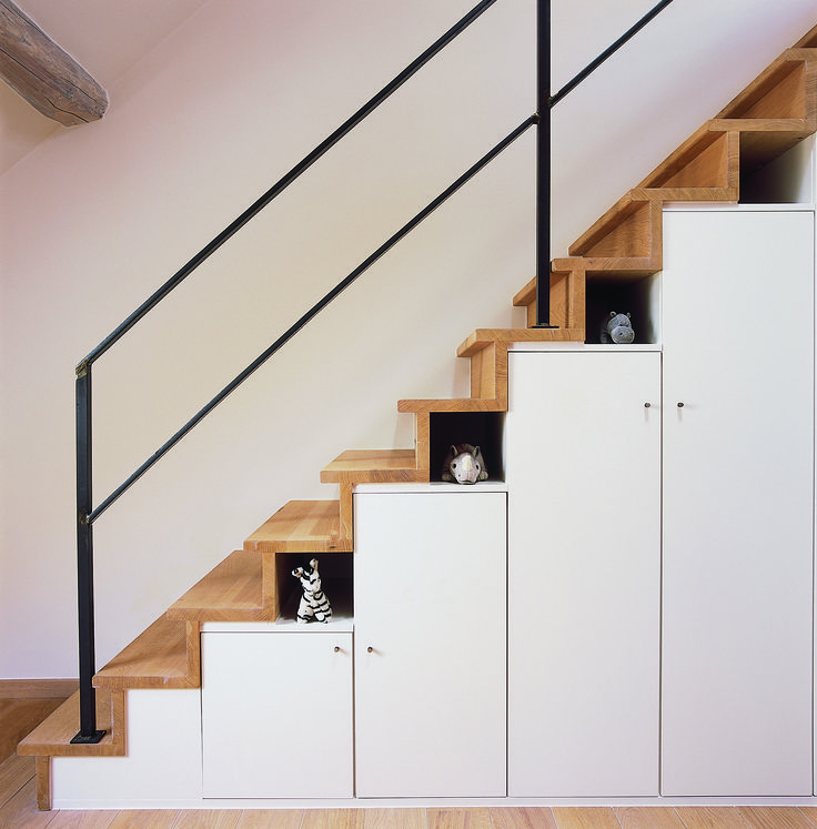 I like the idea of adding shelves and cabinets underneath your stairs.