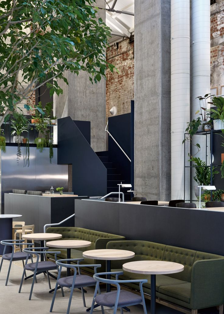 Australian architecture studio DesignOffice has converted a former power station in Melbourne into a cafe and restaurant with exposed brickwork and abundant planting (+ slideshow).