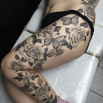 tatuajes de mariposas en la pierna con rosas