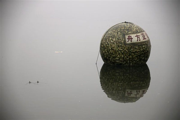 "A spherical pod, named ""Noah's Ark"", designed by Chinese inventor Liu Qiyuan floats on a river during a test in Xianghe, Hebei province, December 12, 2012. Liu, who has spent 1.8 million yuan ($288,000) on building six ""Noah's Ark""s in 8 months with the help of his former furniture factory's workers, is working on his seventh pod. The 17 cubic-metre volume vessels were built to serve as lifeboats in the event of earthquakes, tsunamis and floods. REUTERS/Petar Kujundzic"