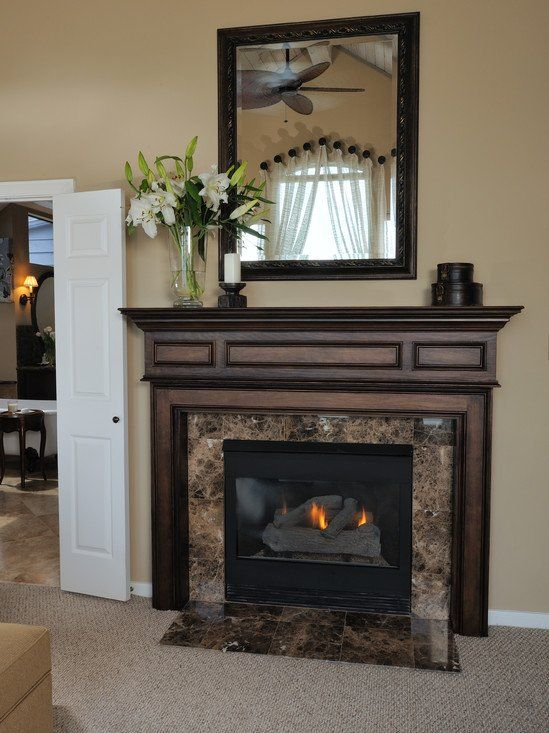 Emperador dark marble surround marble and granite for Wood fireplace surround designs