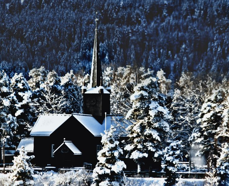 Church covered in snow - Norwegian old church covered in snow in the morning sunlight.