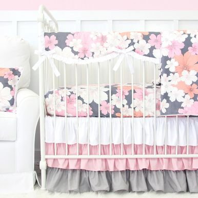 This 2 pc. set features a pink and gray floral pattern crib sheet and a coordinating pink and gray ruffle crib skirt. This set is perfect for any baby girl's nursery!