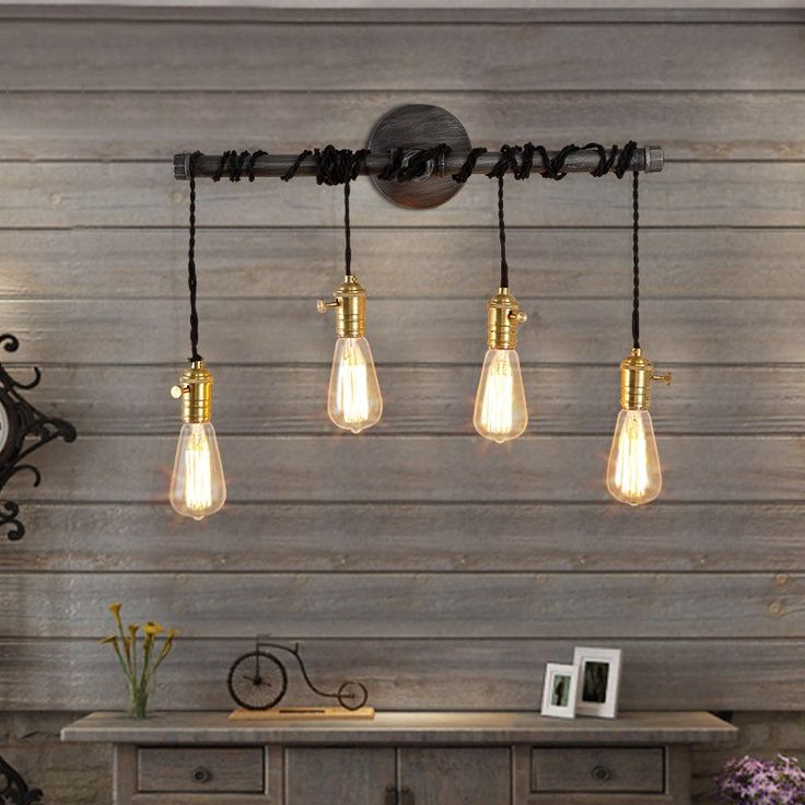 A Slender, Horizontal Plumbing Pipe Suspending Four Exposed Vintage Bulbs  With Black Twisted Wire Makes This Beautiful Wall Light And Offers An Array  Of ...