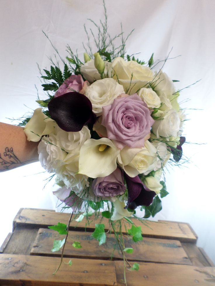 Small cascading wedding bouquet in creams, lilacs and purples. Designed by Florist ilene, Hamilton, NZ