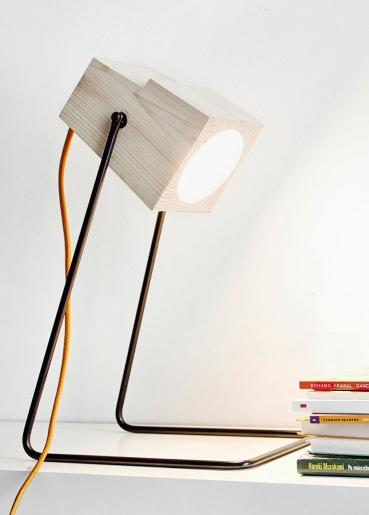 360° table lamp by Polish designer Magdalena Chojnacka. The head is made from a solid block of Pine wood, and has a pivot mechanism that allows for 360 degree swivel so user can adjust light source where desired. The base is made from powdercoated steel, and the bulb is LED.