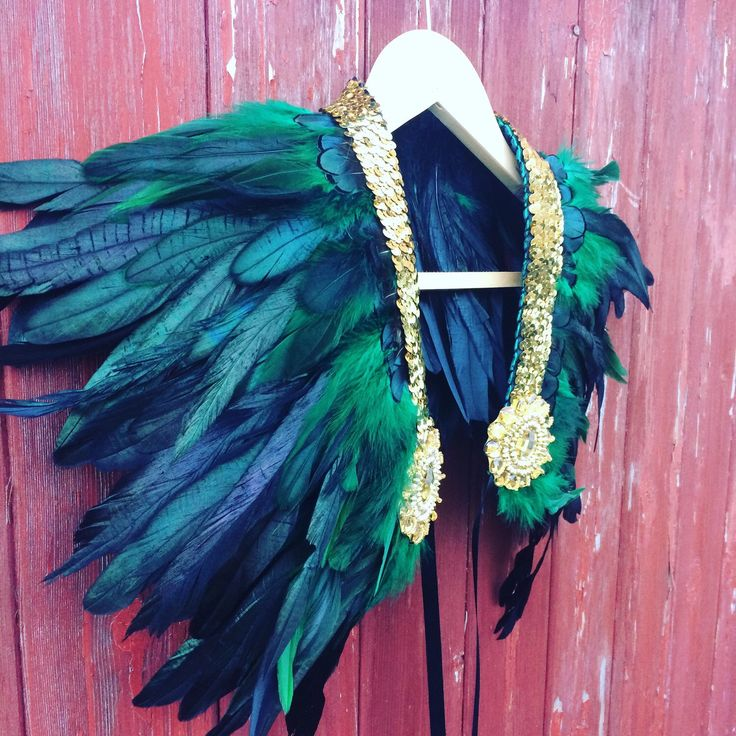 Brand new listing! Gorgeous handcrafted black and emerald green feather and sequin shrug. Perfect for the party season ahead!